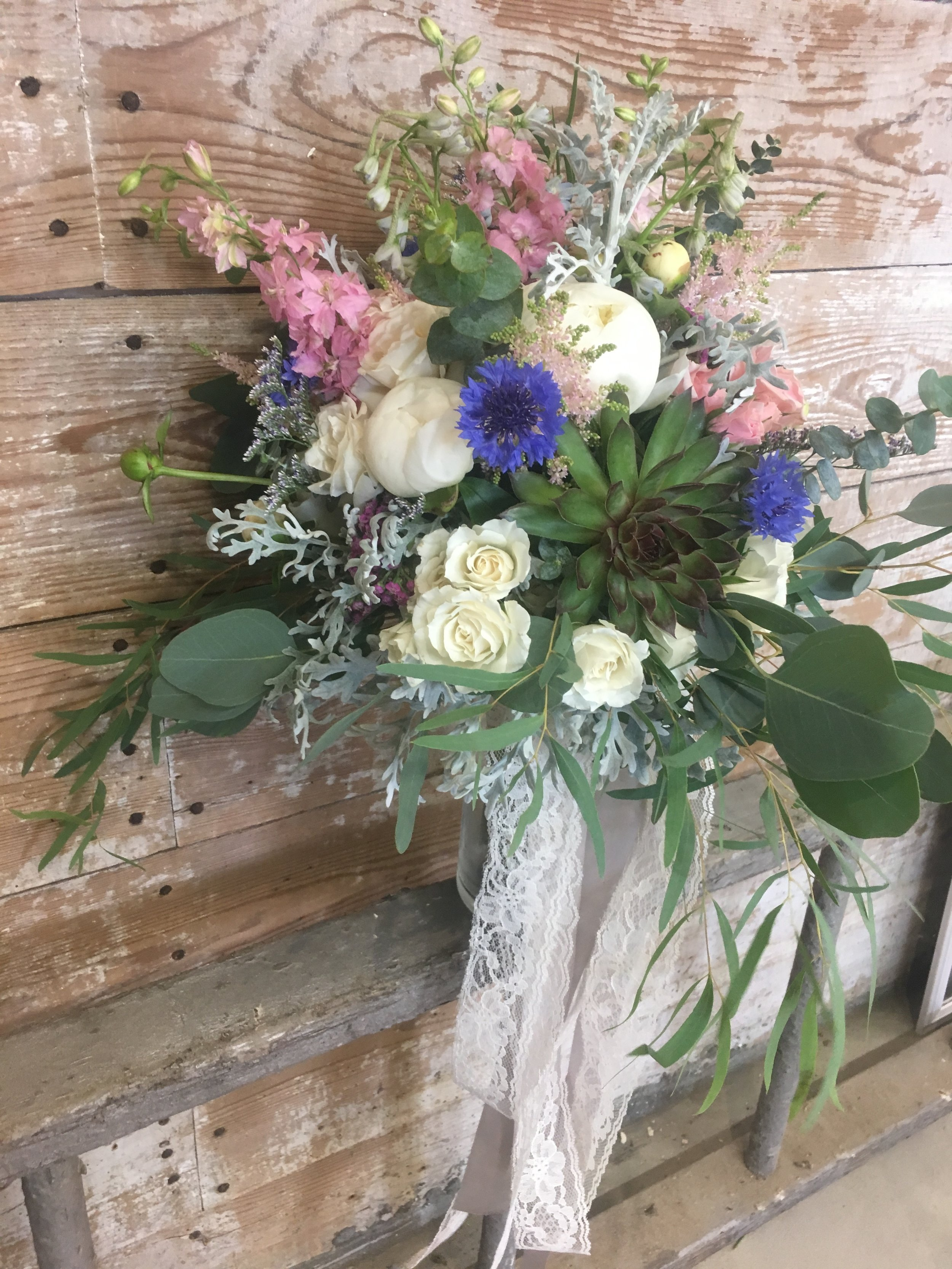 Every boho bride needs wildflowers, succulents, and lace ribbon!!