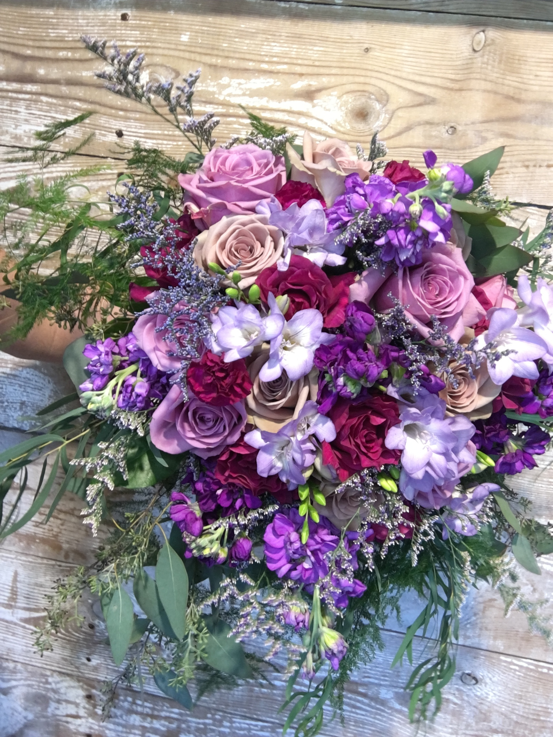 """Go Bold or Go Home! This bride wanted """"wow"""" factor florals and this purple stunner did not disappoint!"""