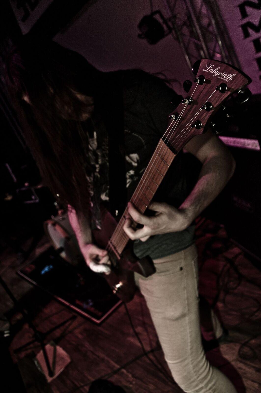 Levi Live - Headstock Shot.jpeg