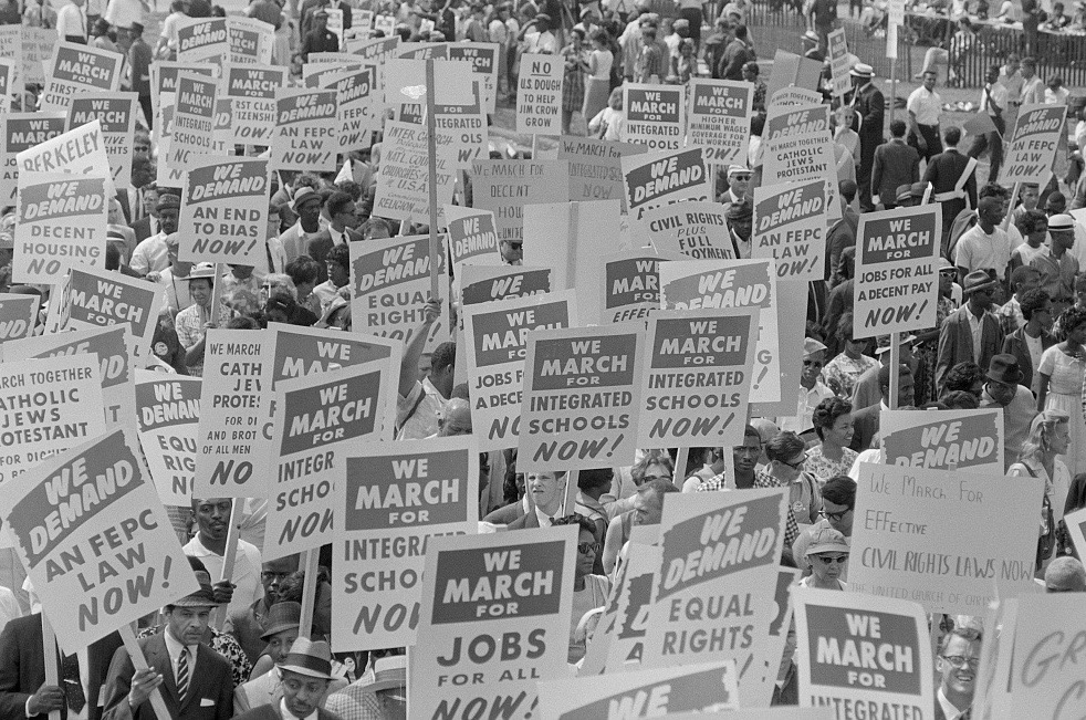 PAGE 75: ATTENDEES OF THE MARCH ON WASHINGTON FOR JOBS AND FREEDOM ARE SHOWN CARRYING PLACARDS ON THE NATIONAL MALL IN WASHINGTON, DC (PERMISSION OF THE LIBRARY OF CONGRESS, PRINTS AND PHOTOGRAPHS DIVISION).