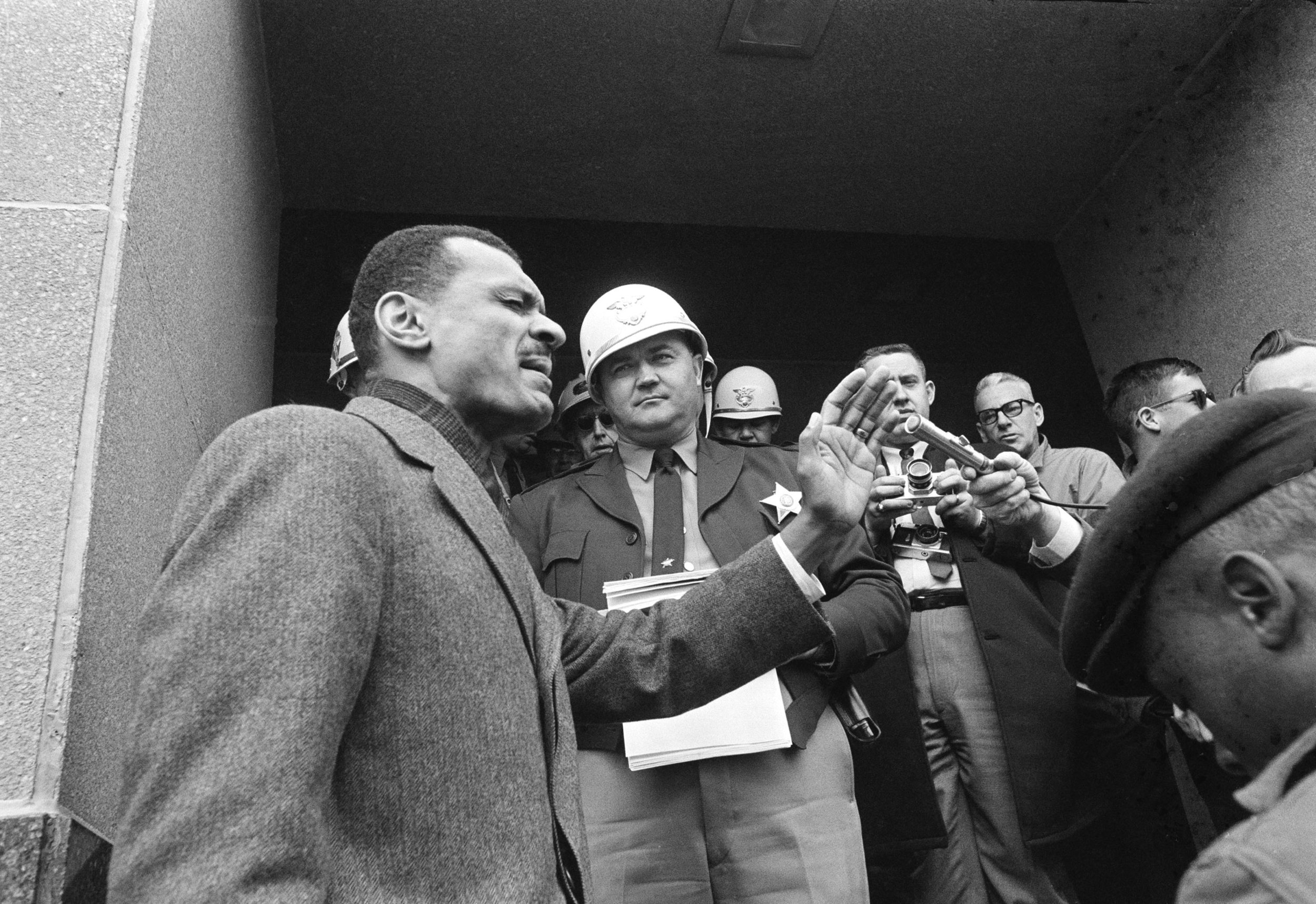 PAGE 89: IN JANUARY 1965, SCLC DIRECTOR REV. C.T. VIVIAN LED A GROUP OF DEMONSTRATORS IN PRAYOR AS THEY ATTEMPTED TO ENTER THE DALLAS COUNTY COURTHOUSE TO REGISTER TO VOTE. DEPUTY SHERIFF JIM CLARK STRUCK REV.VIVIAN DURING A NATIONALLY TELEVISED PROGRAM (PERMISSION OF THE ASSOCIATED PRESS).