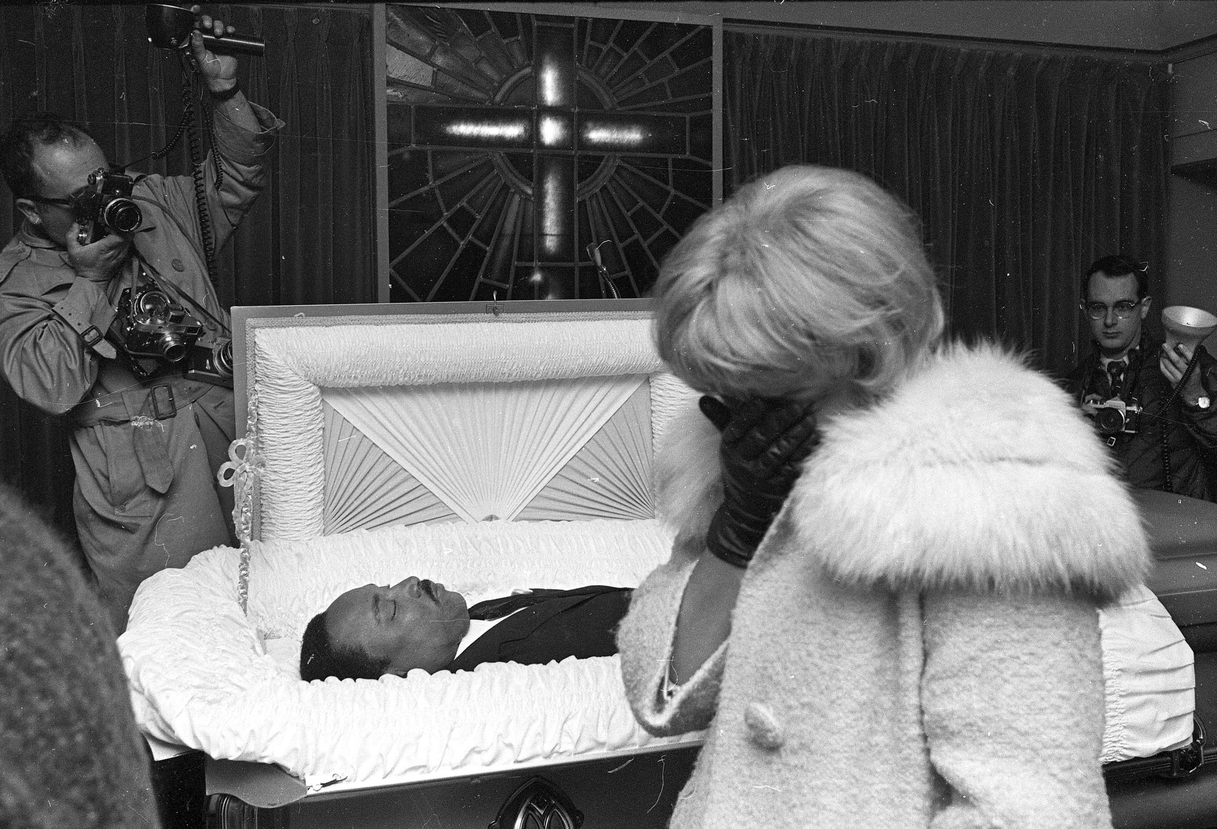 PAGE 114: DR. KING WAS ASSASSINATED ON APRIL 4, 1968. BEFORE THE SLAIN CIVIL RIGHTS LEADER'S BODY WAS RETURNED TO ATLANTA, A FUNERAL WAS HELD FOR MOURNERS IN MEMPHIS, TENNESSEE. AN UNIDENTIFIED WOMAN CONCEALS HER FACE AS SHE GRIEVES OVER THE LOSS OF THE CIVIL RIGHTS LEADER (PERMISSION OF THE ASSOCIATED PRESS).