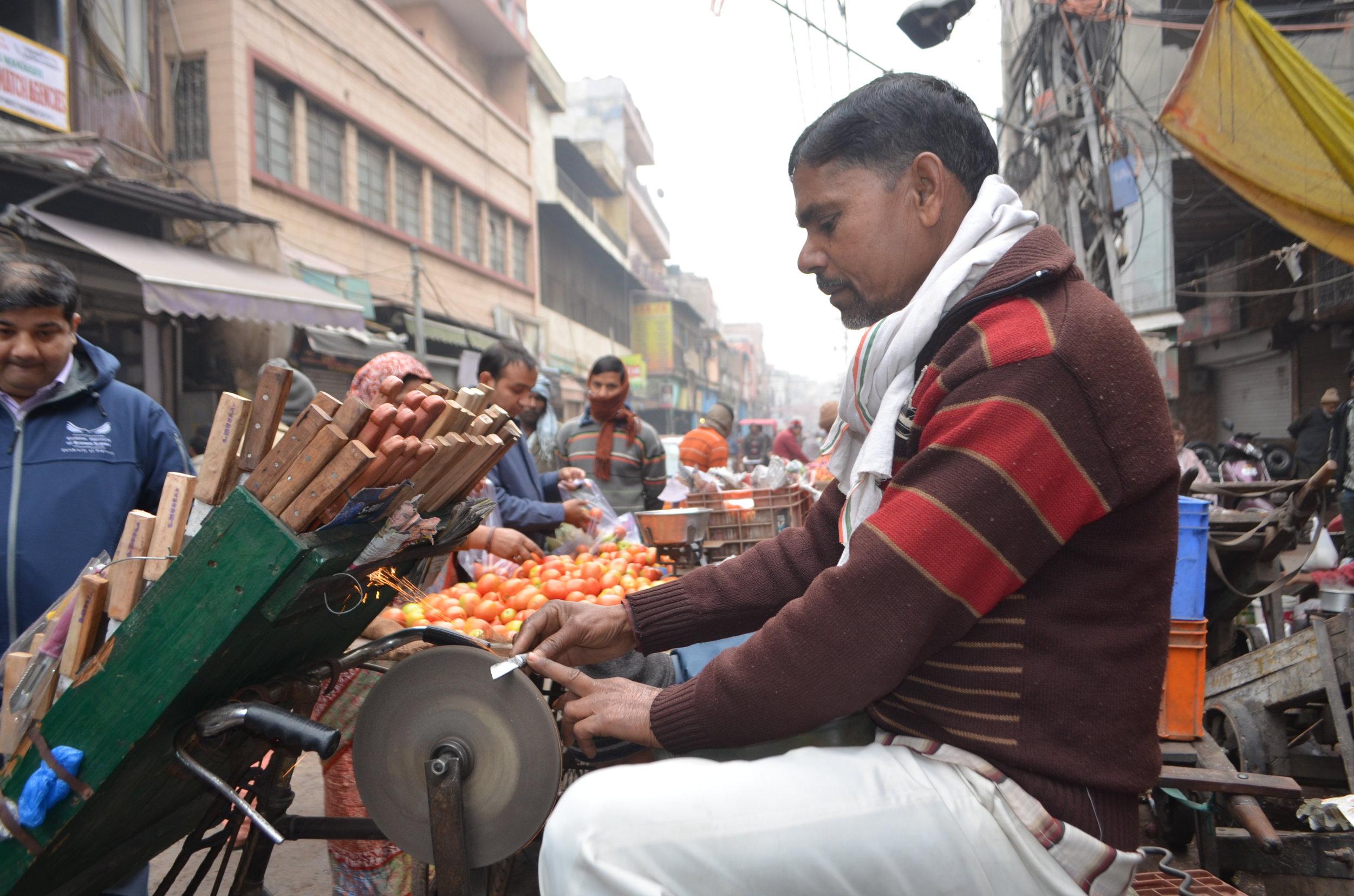 Old Delhi Market  knife sharpening Beacon Holidays India Tours