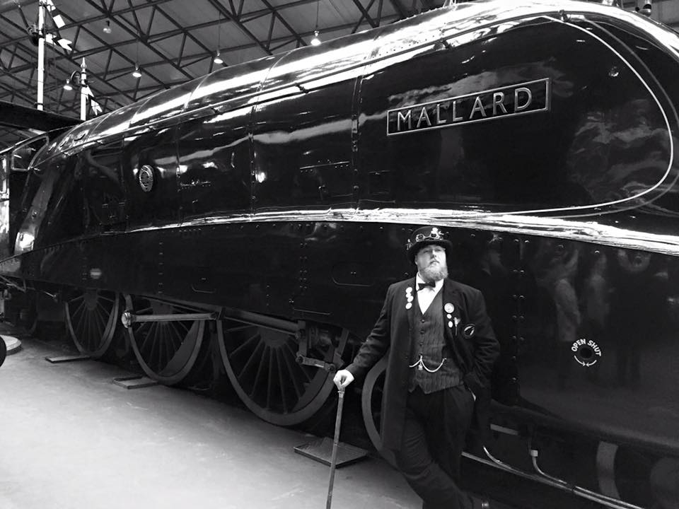 Lincoln Steampunk Society Member with Steam Train