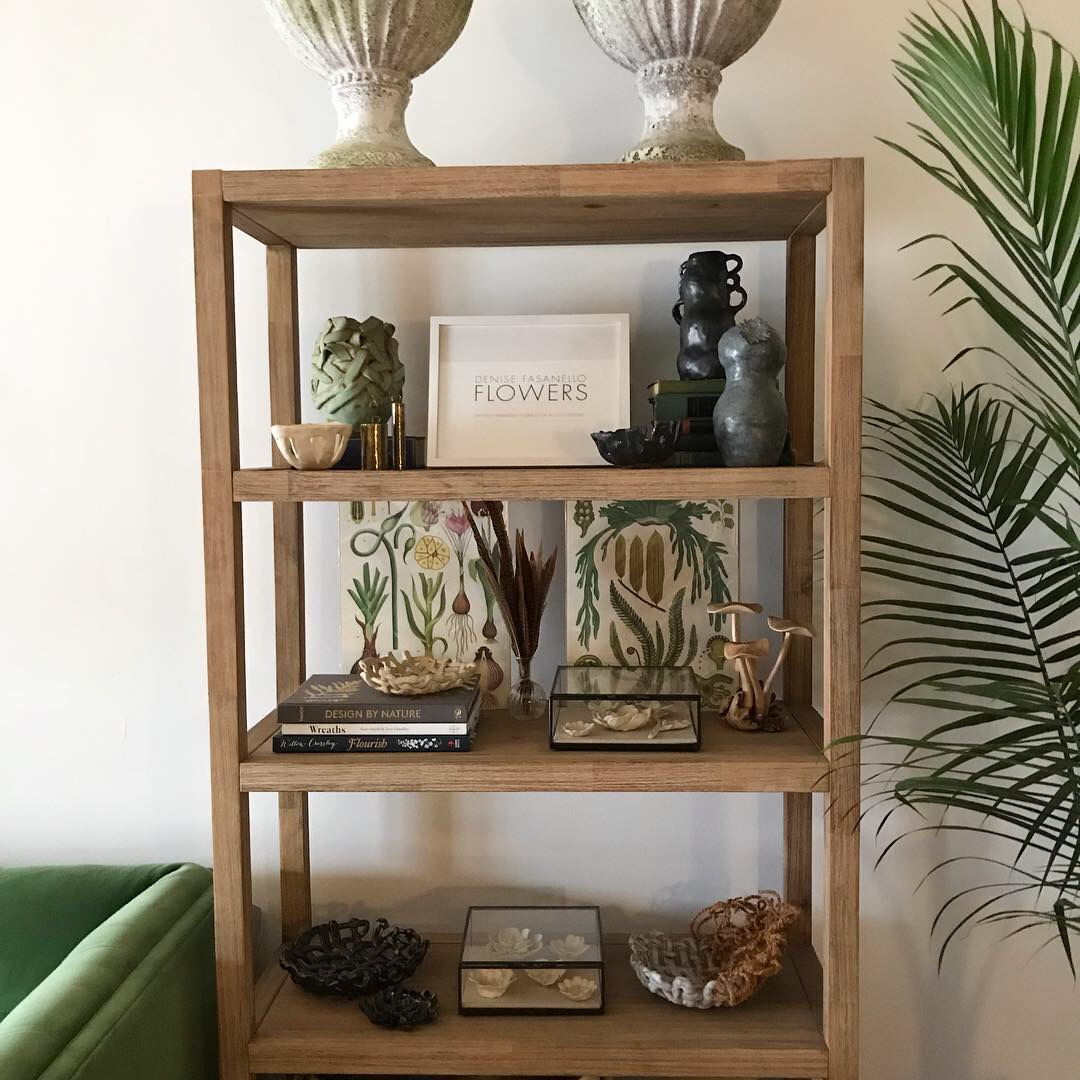 Display shelf holding some of my handmade ceramics and current favorite design books