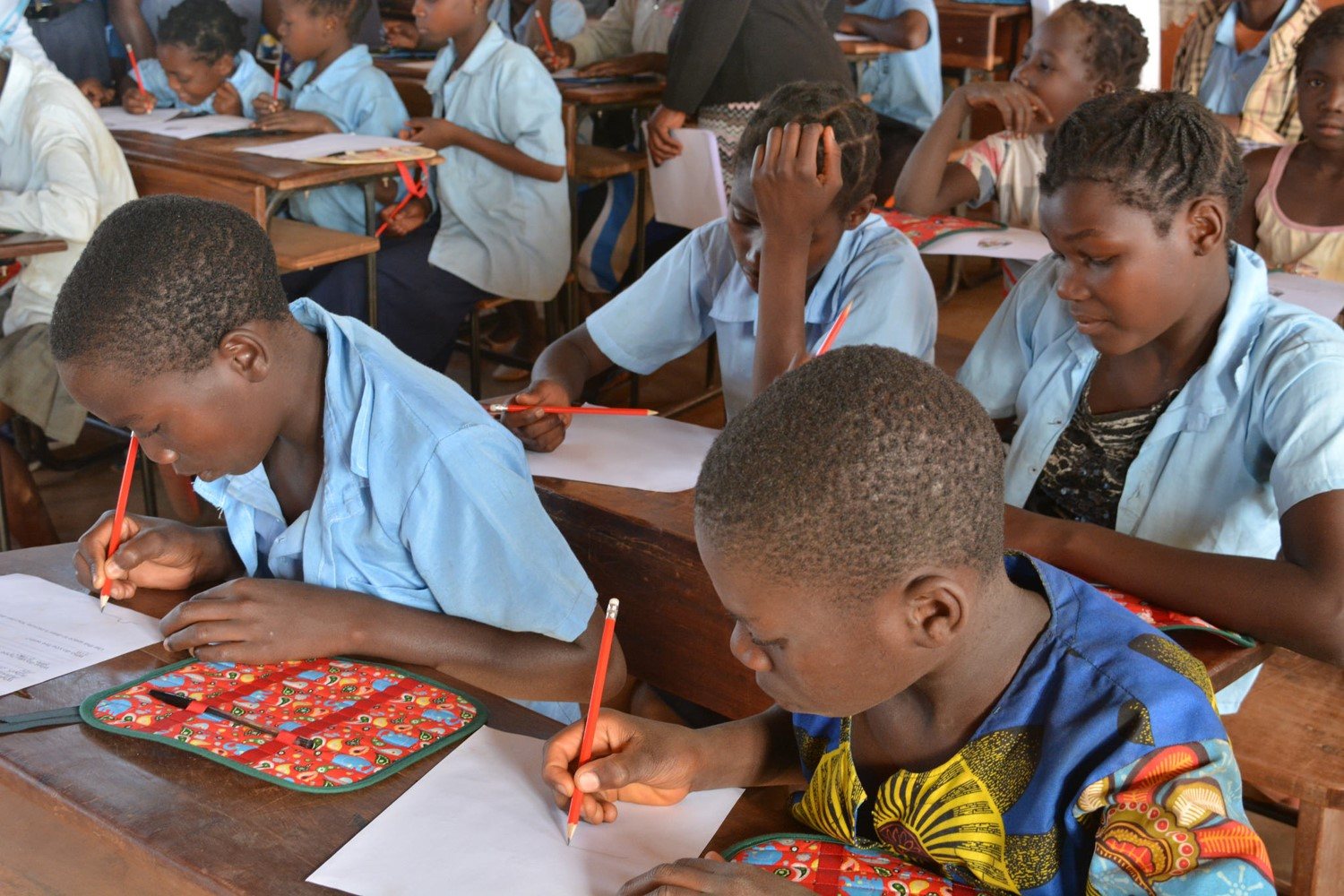 A photo of children in Mozambique working at school