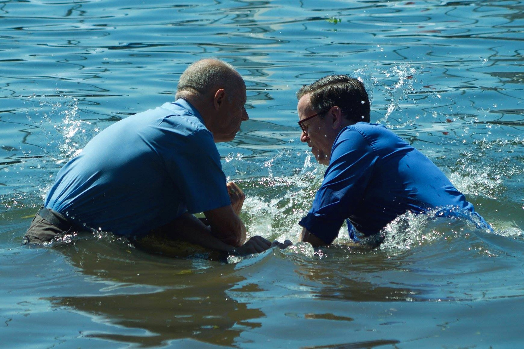 A photograph of a church member being baptised in the River Thames