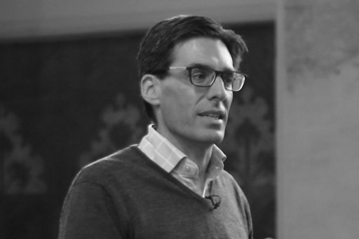 A black and white photograph of theologian, Mark Scarlata