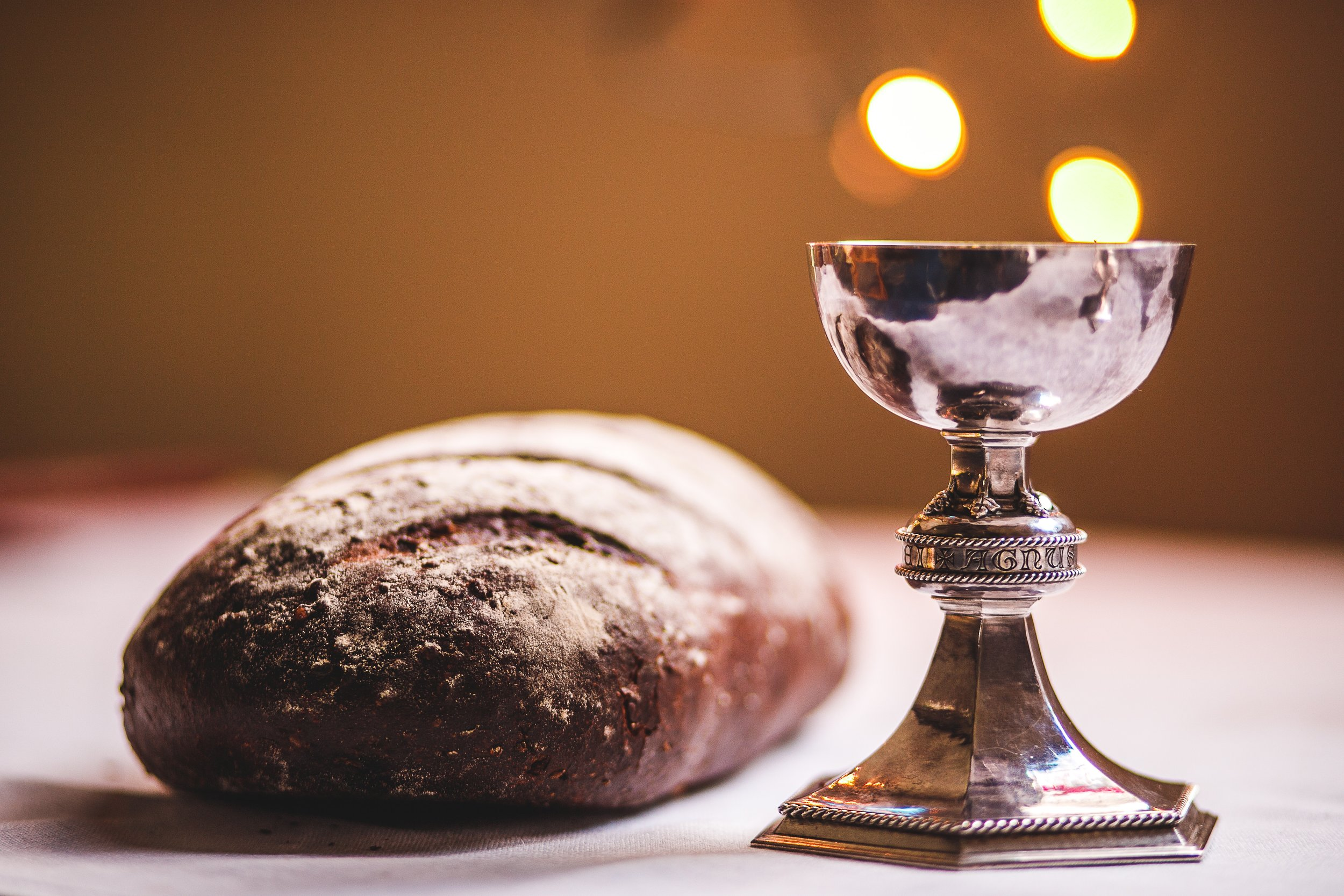 A photograph of bread and wine