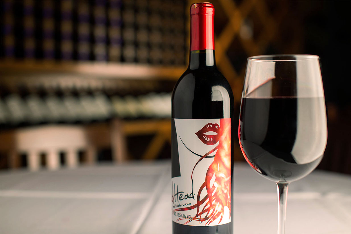 Red Blend - This sweet & spicy blend of California Zinfandel & Carmenere offers notes of ripe plums, cherries, and blackberries with a fiery kick at the finish. Our velvety smooth, fruity & lightly spicy blend captures the profile of a fine wine and the spirit of a sassy redhead.