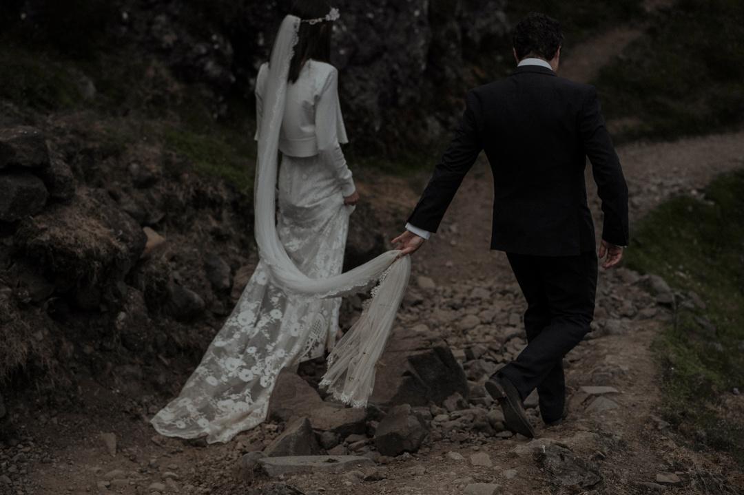 groom holding veil