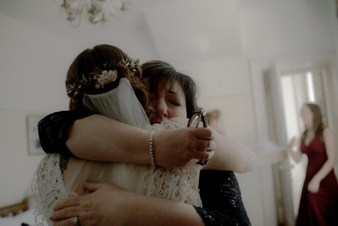 mum is hugging daughter
