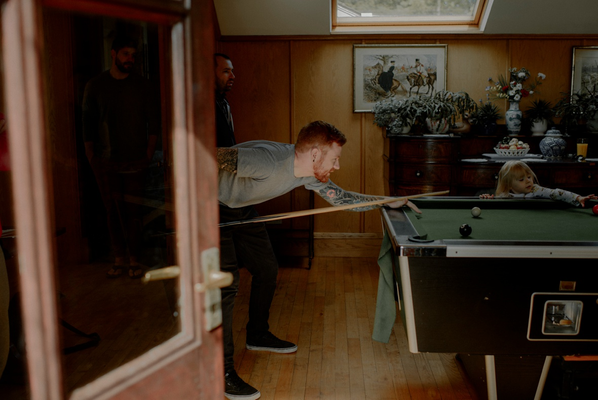man is playing pool