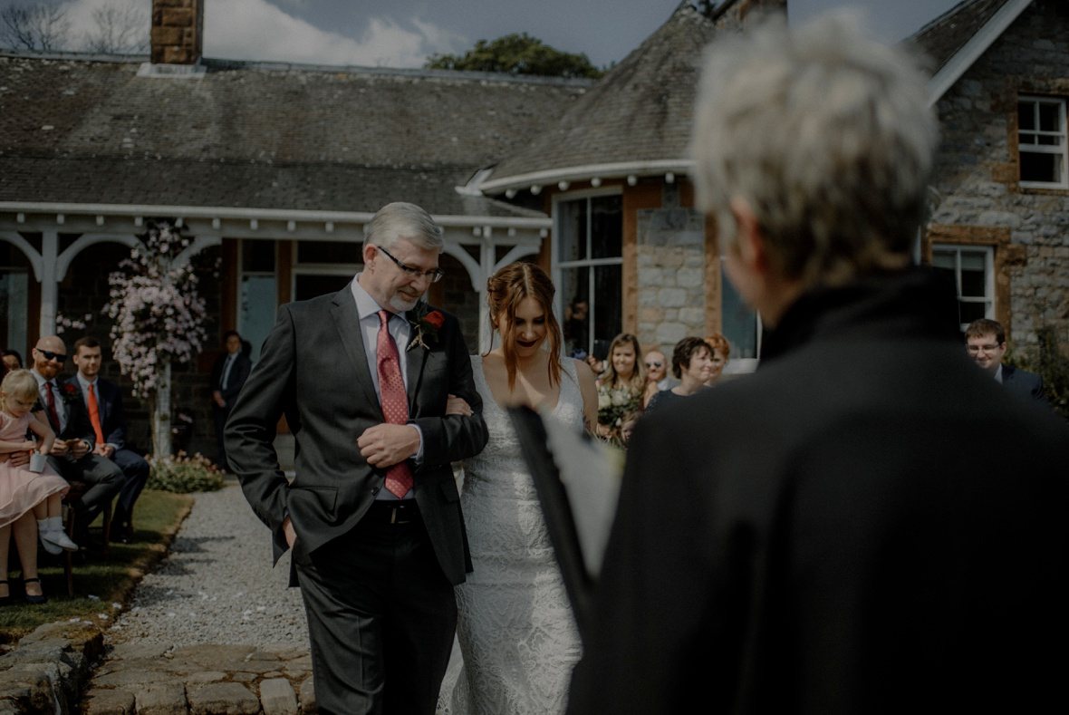 bride and her father walking