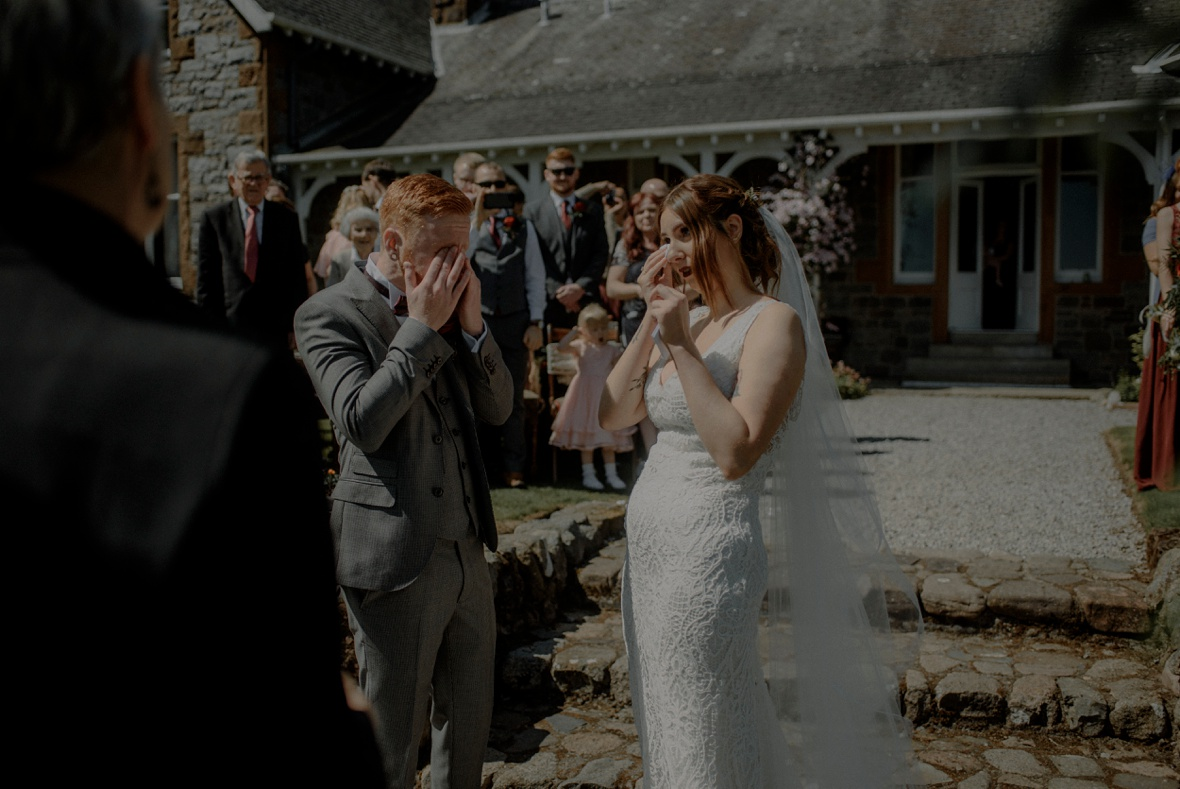 couple is crying at ceremony