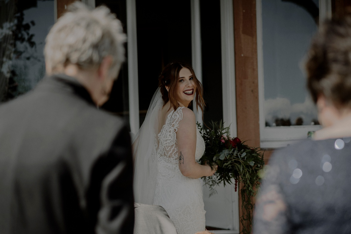 bride is looking back and laughs