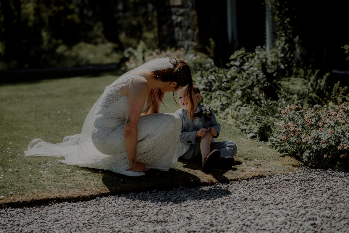 bride is chatting to a little boy