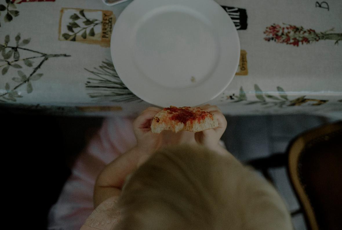 little girl is having dinner