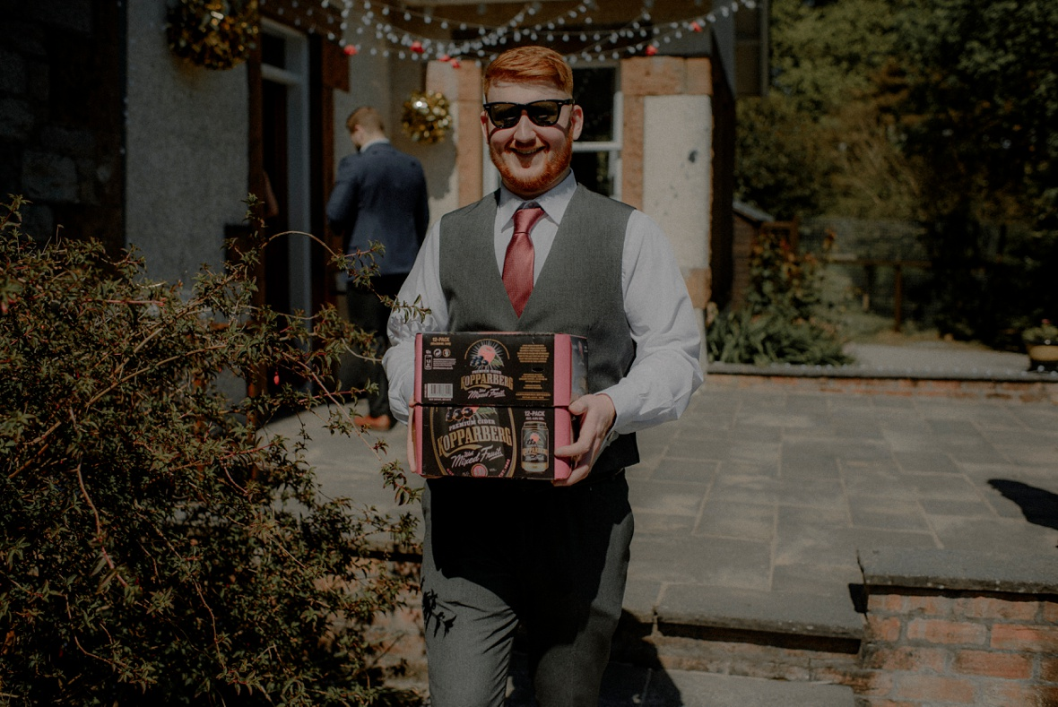 guy carrying box of beer