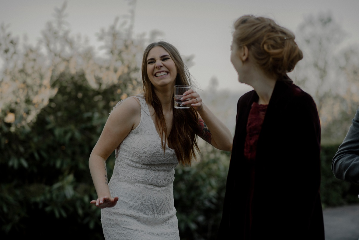 bride is dancing with drink in hand