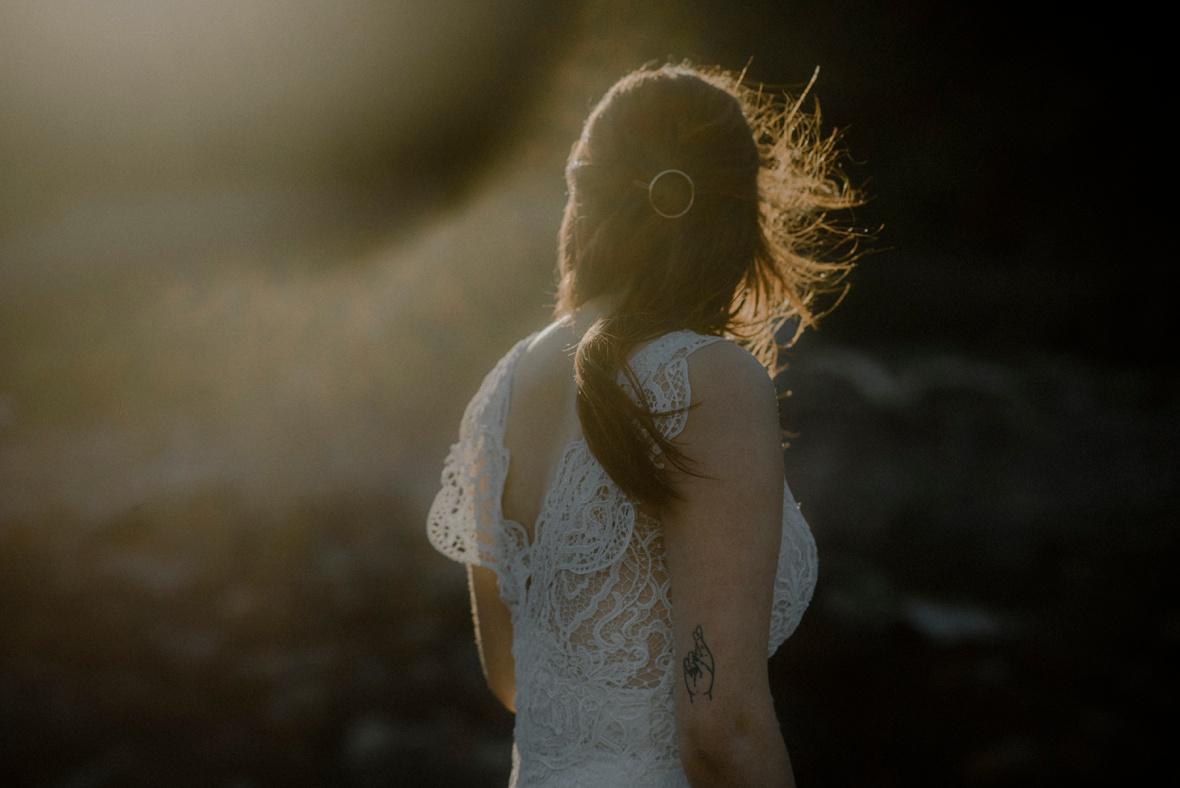 golden evening light is falling onto bride's hair