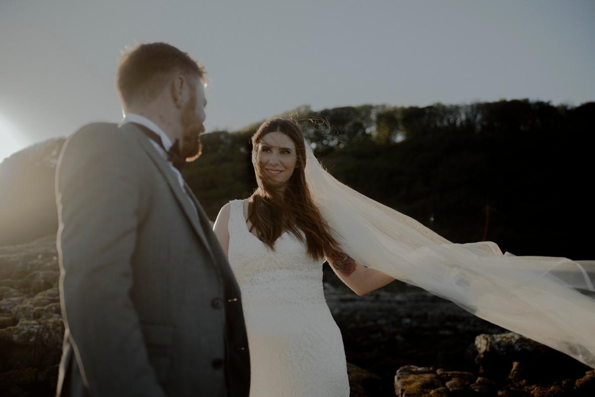 bride is lovingly looking at her groom