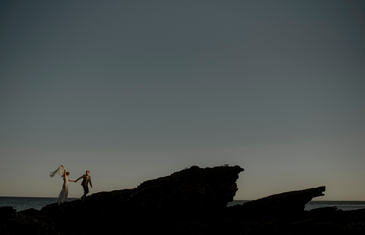 married couple on cliff