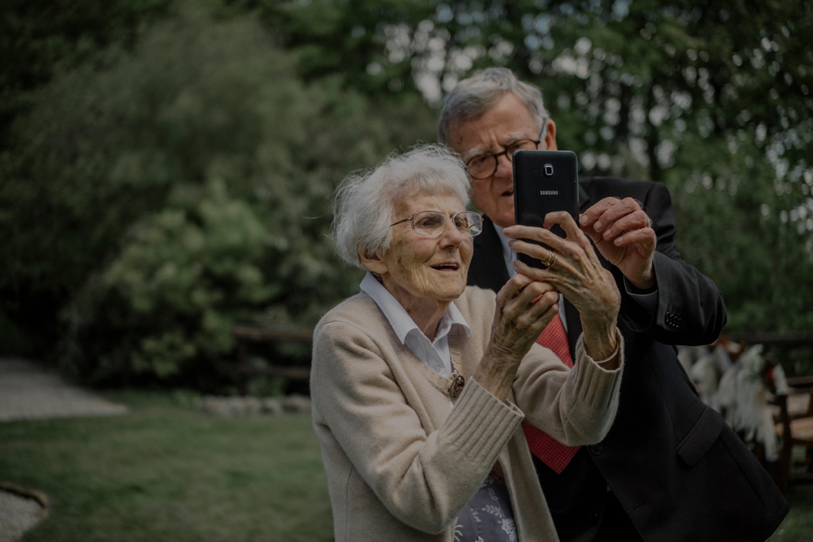 granny holding smartfone