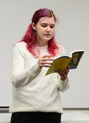 "Elmira 4-H Club member Kailey Mauldin reads passages from the New York Times' bestseller, ""The Secret Life of Bees,"" written by Sue Monk Kidd. (Photo by Kathy Keatley Garvey)"