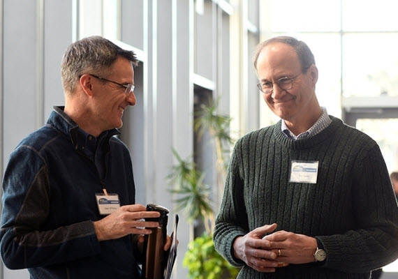 Professor Tom Seeley (right) of Cornell University chats with UC Davis Professor Neal Williams following Seeley's keynote address of the 2018 UC Davis Bee Symposium. (Photo: Kathy Keatley Garvey)