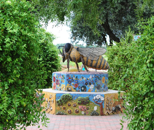 "A ceramic/mosaic sculpture, ""Miss Bee Haven,"" anchors the Haagen-Dazs Honey Bee Haven on Bee Biology Road, UC Davis. It is the work of self-described rock artist Donna Billick of Davis. (Photo by Kathy Keatley Garvey)"