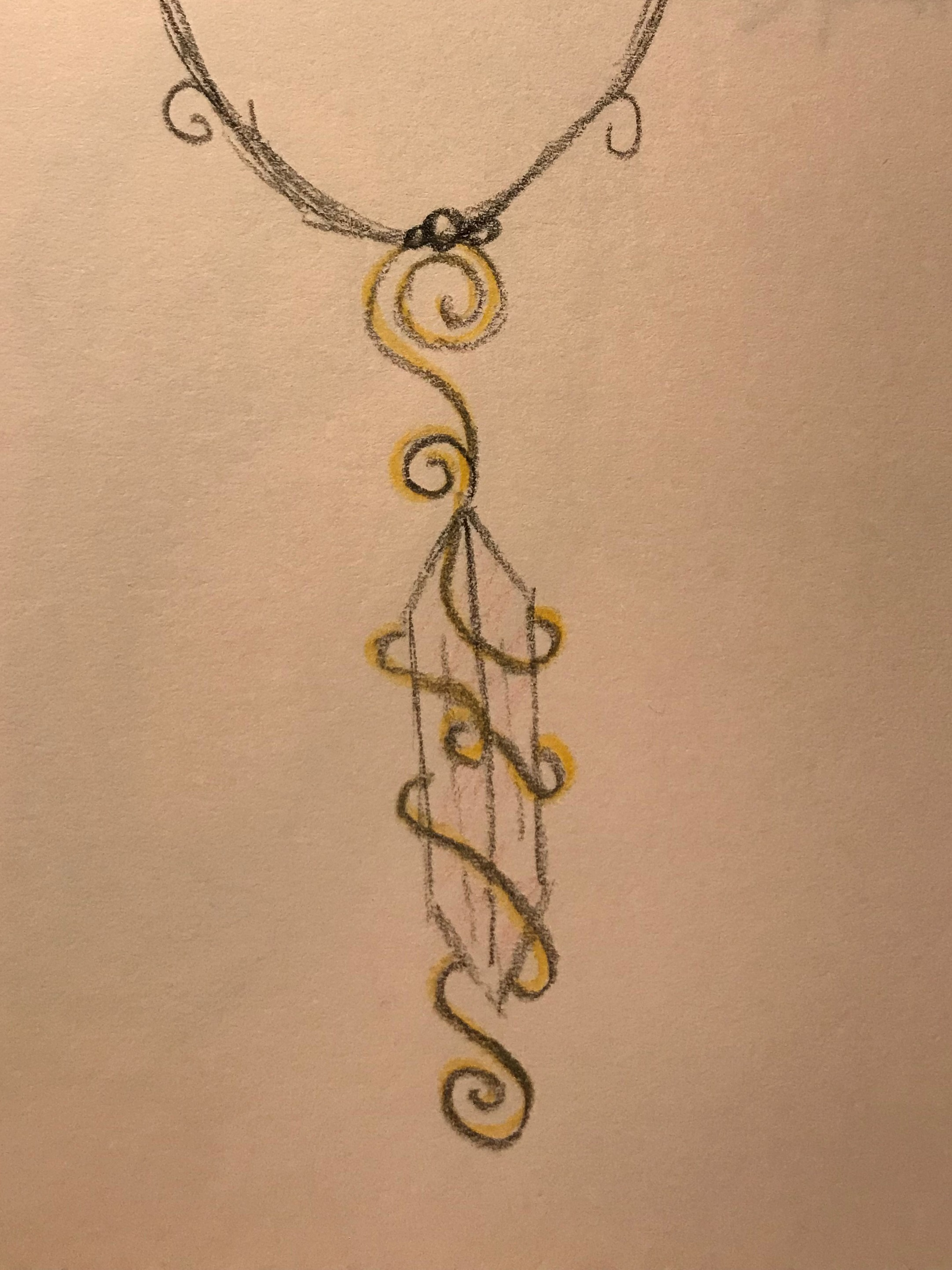 Spiral Wrapped Crystal - This spiral wire wrapped Crystal uses an interesting twist on the usual wire wrapping. I like the extra curls and loops.