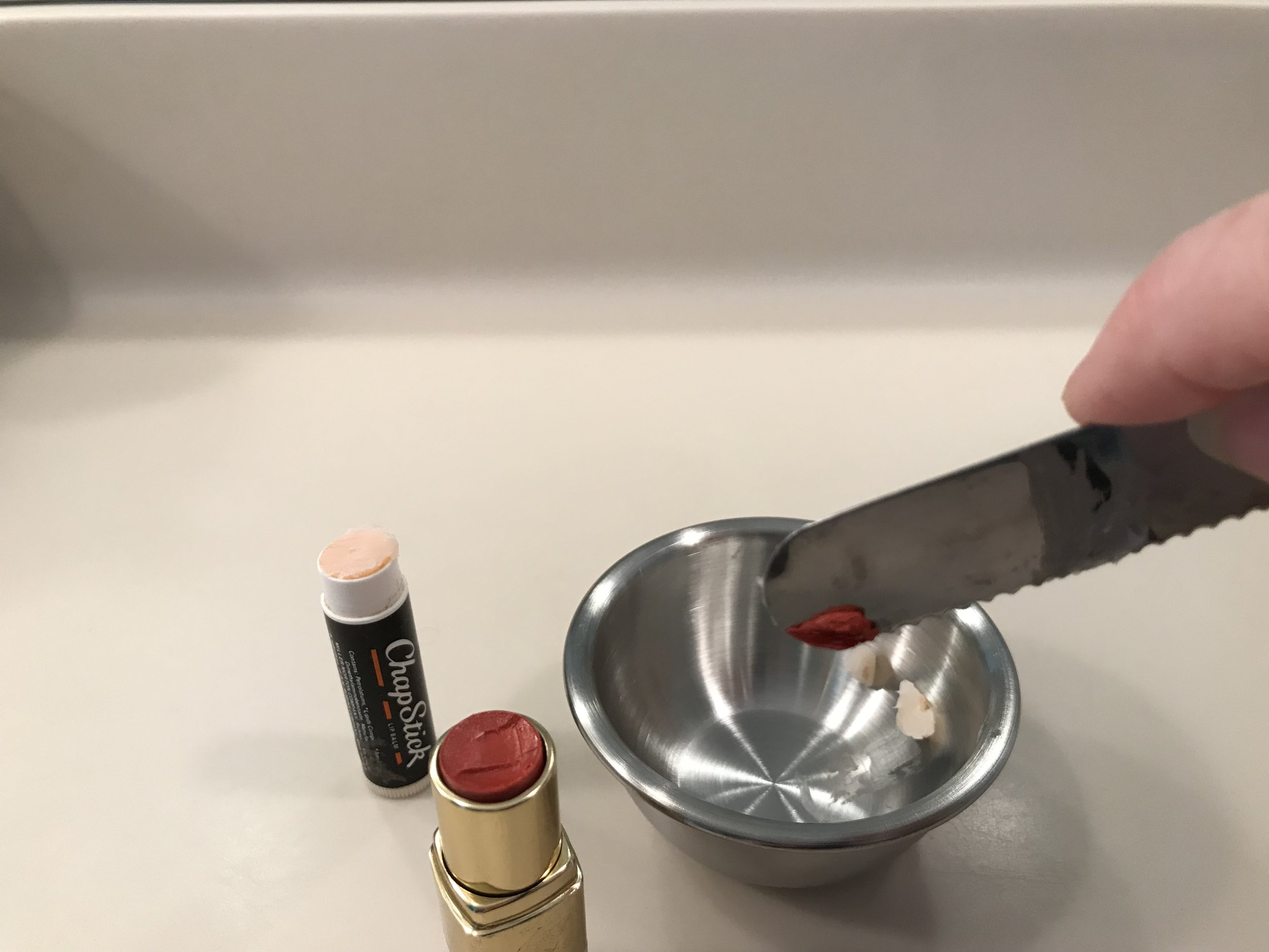 Place both lip balm and lip color in the bowl.