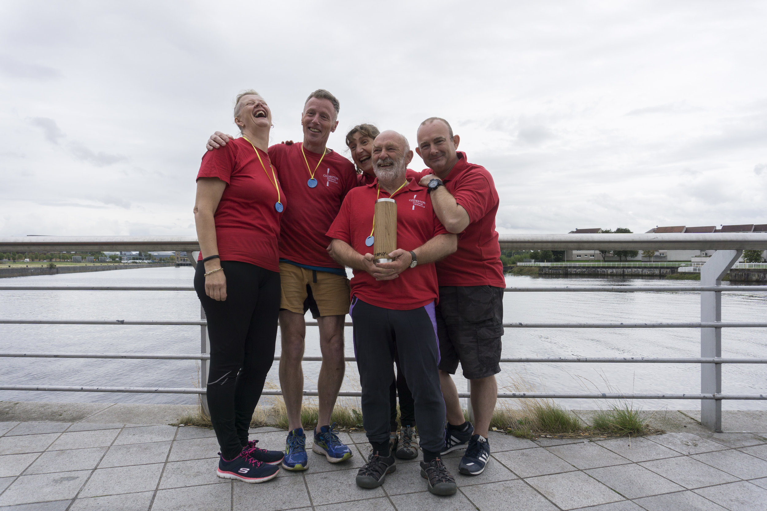 "Collieston Offshore Rowing Club of ""Admiral Redsocks"" hold the Median Trophy   Photo: Sean Campbell"