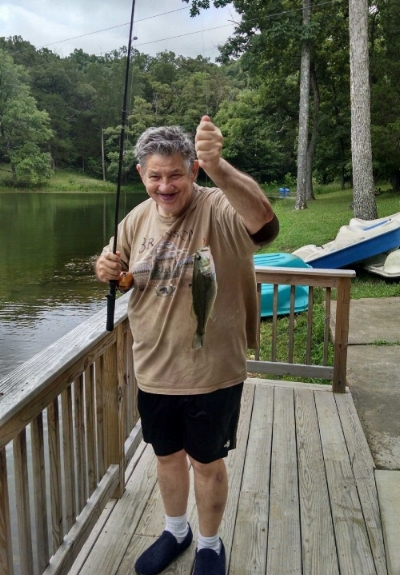 Carl caught a fish while fishing at Sunnyhill U!