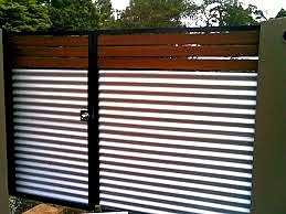 Modern Galvanized Corrugated Panels with Metal Posts and Wood Slats.