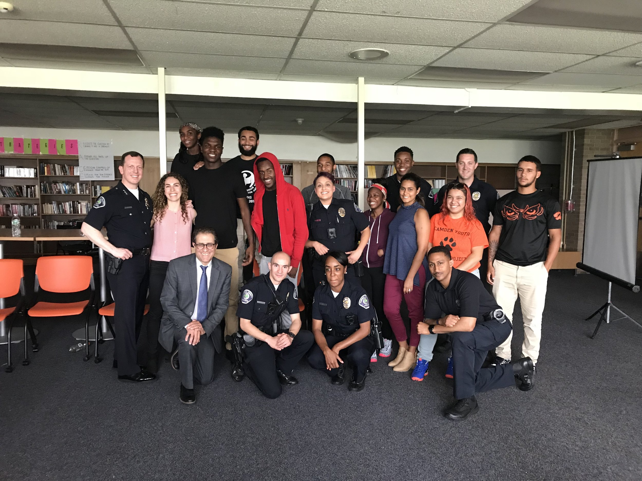 Our Camden Youth-Police Engagement Program participants celebrate with our staff and members of the Camden County Police Department, including Chief of Police Scott Thomson, after completing their final presentation.