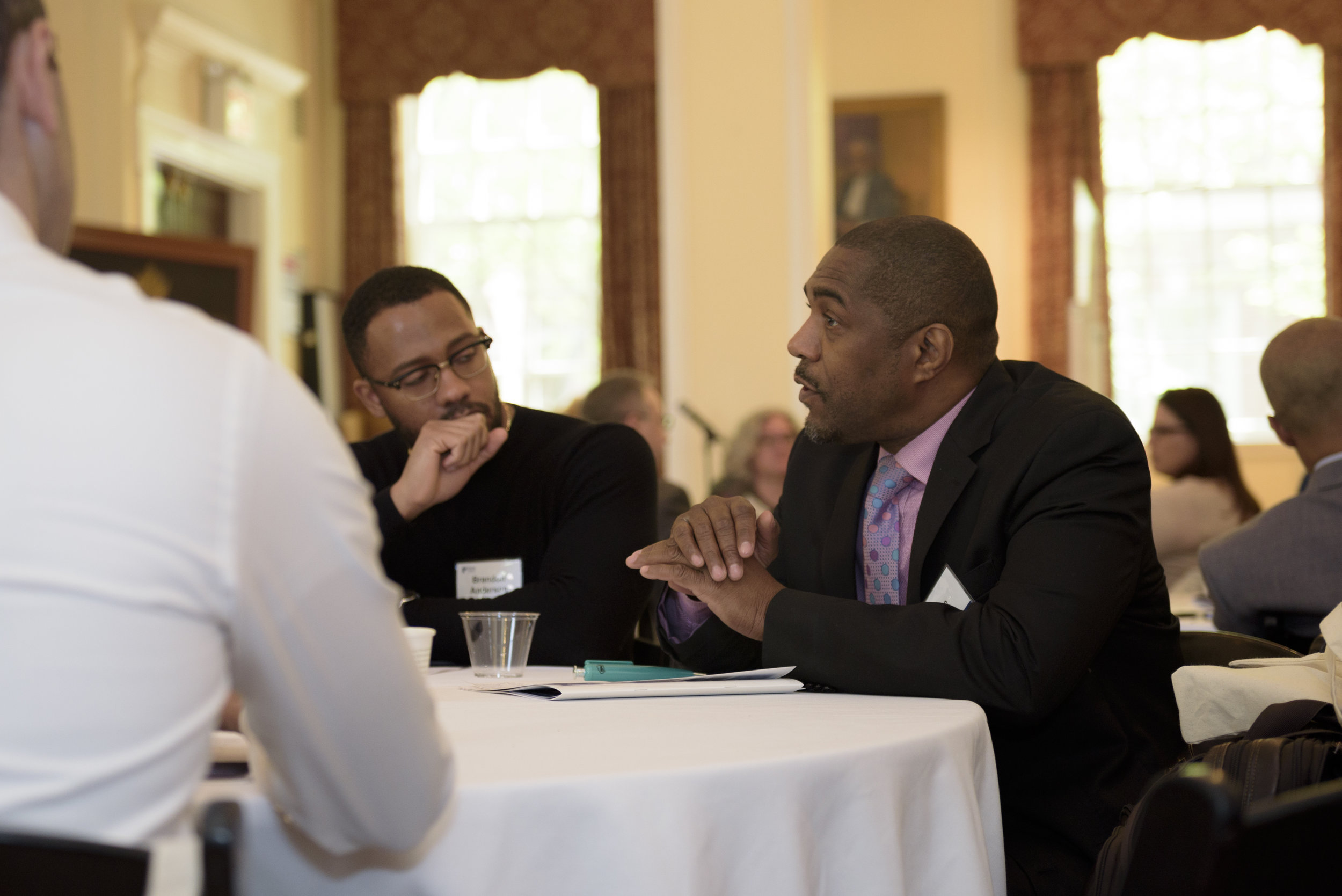 Divine Pryor, executive director of Center for Nuleadership on Urban Solutions, with Brandon Anderson, founder of Raheem AI.