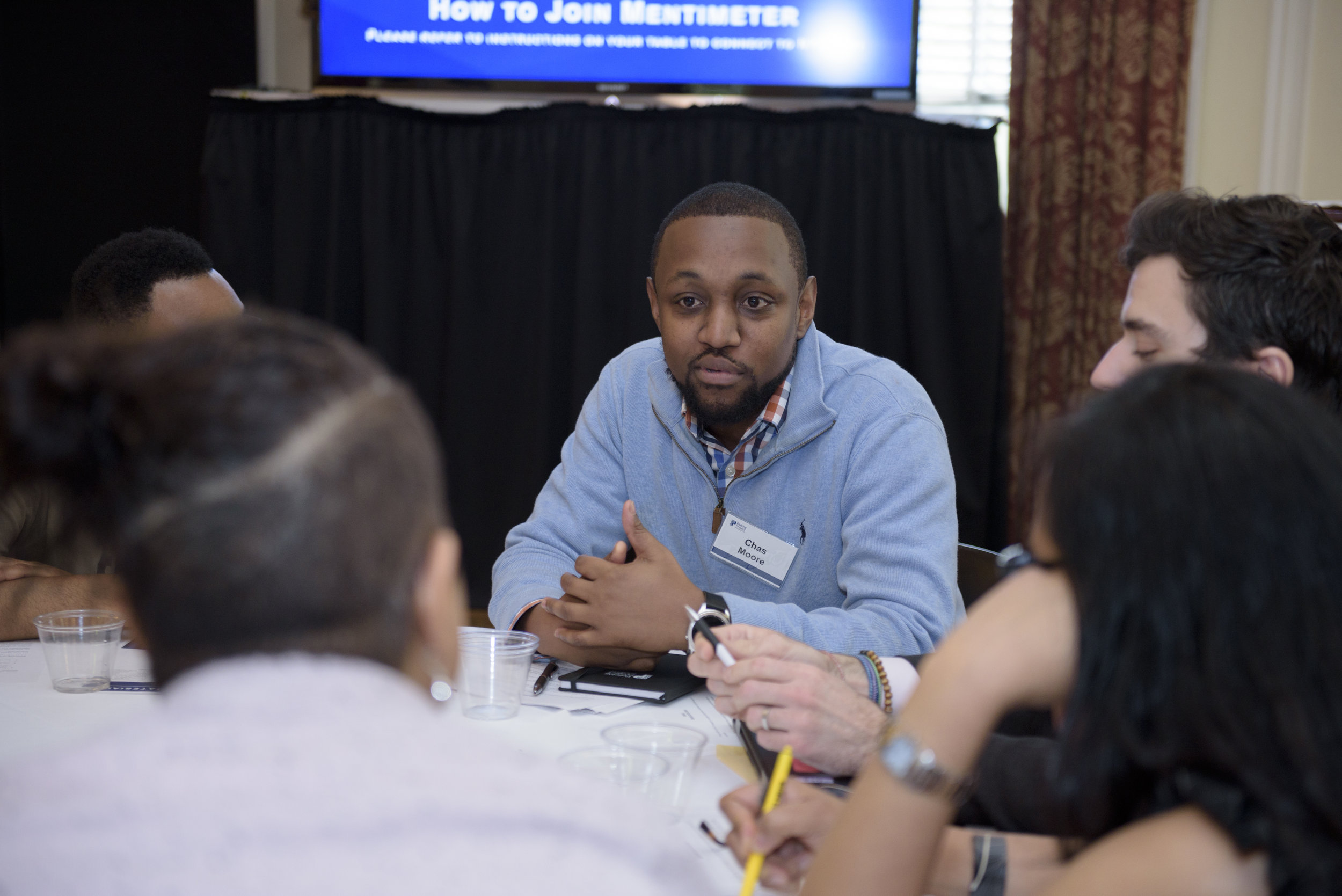 Chas Moore, executive director and founder of Austin Justice Coalition, in small group discussion.