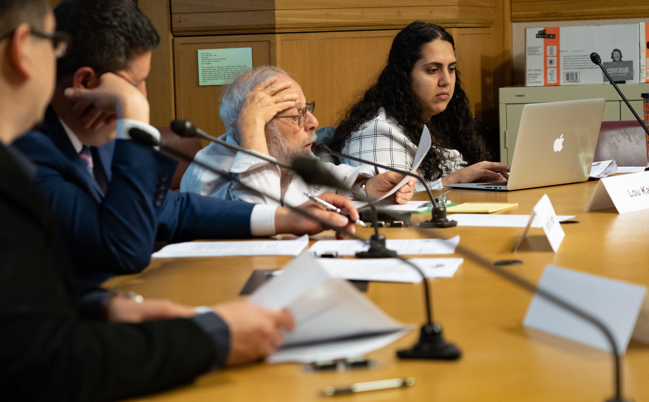 OPAC members Brian Hofer, Lou Katz, and Reem Suleiman review notes during the Commission's April 2019 meeting.