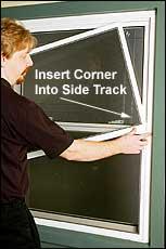 Insert lower right corner slightly into right track.