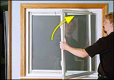 With top pivot bar in top shoe, bring sash completely vertical while closing it flush to window frame.