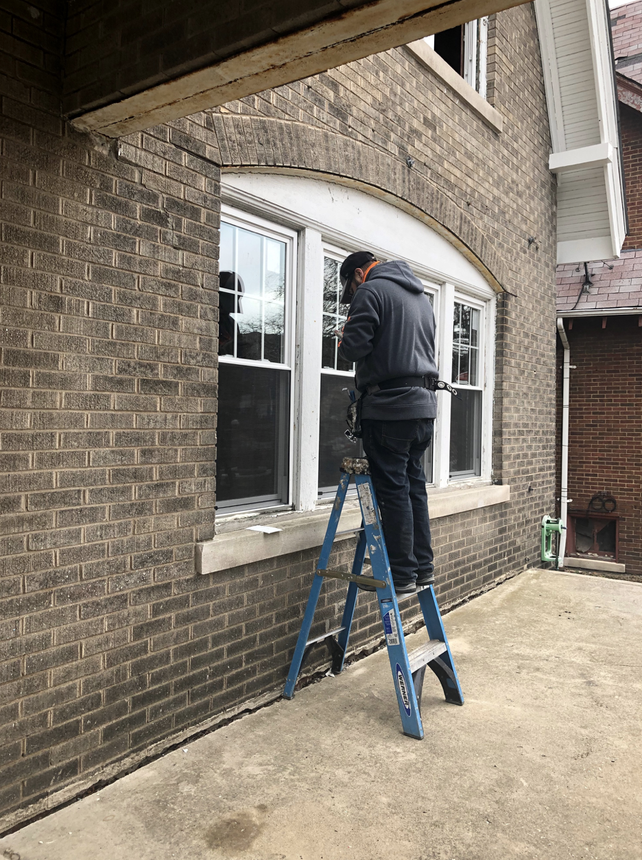 Installers volunteered to place windows in freezing temperatures as part of Life Remodeled this week.