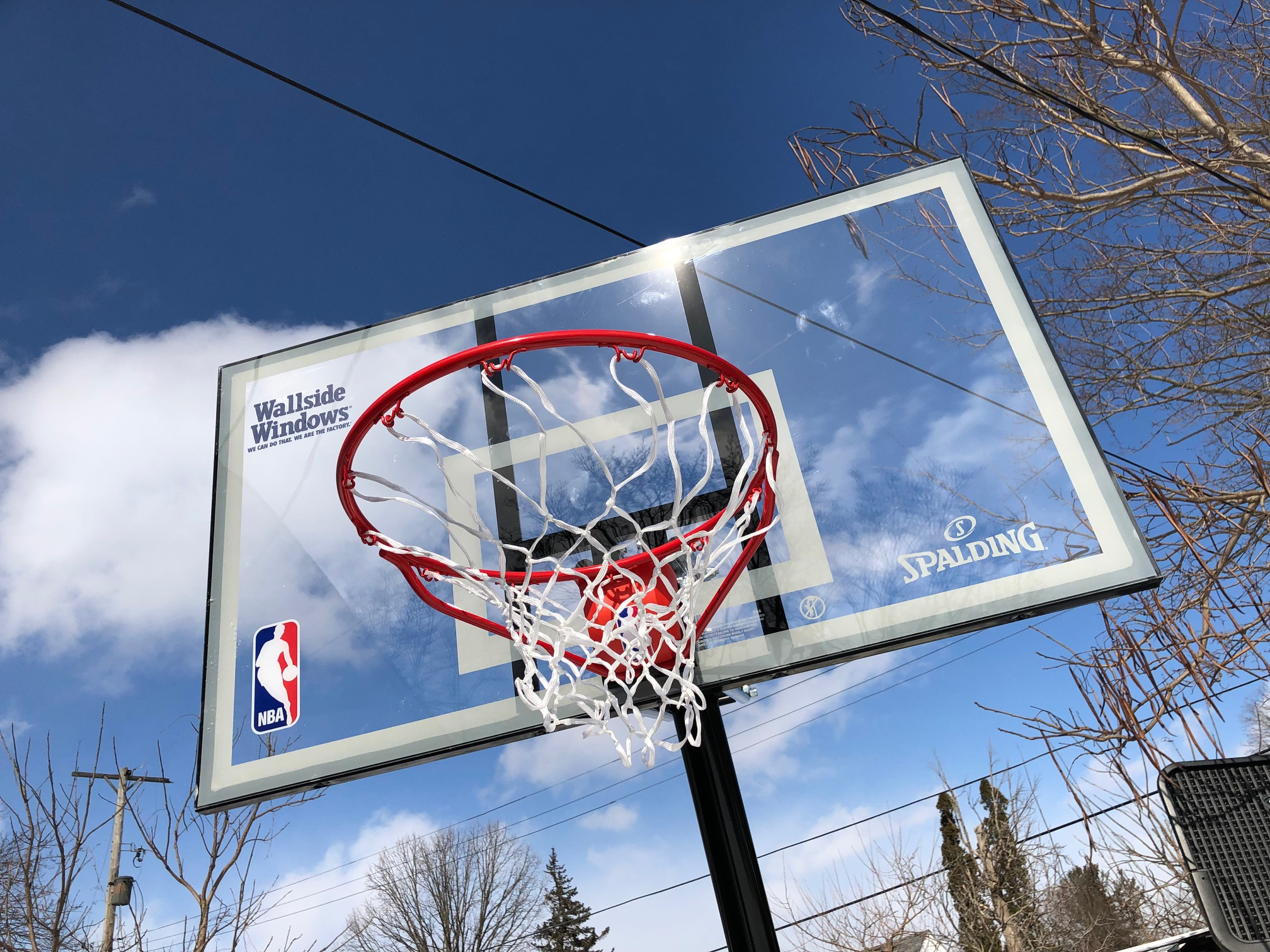 This branded backboard was among the gifts the Hill family received from Wallside Windows and the Detroit Pistons.