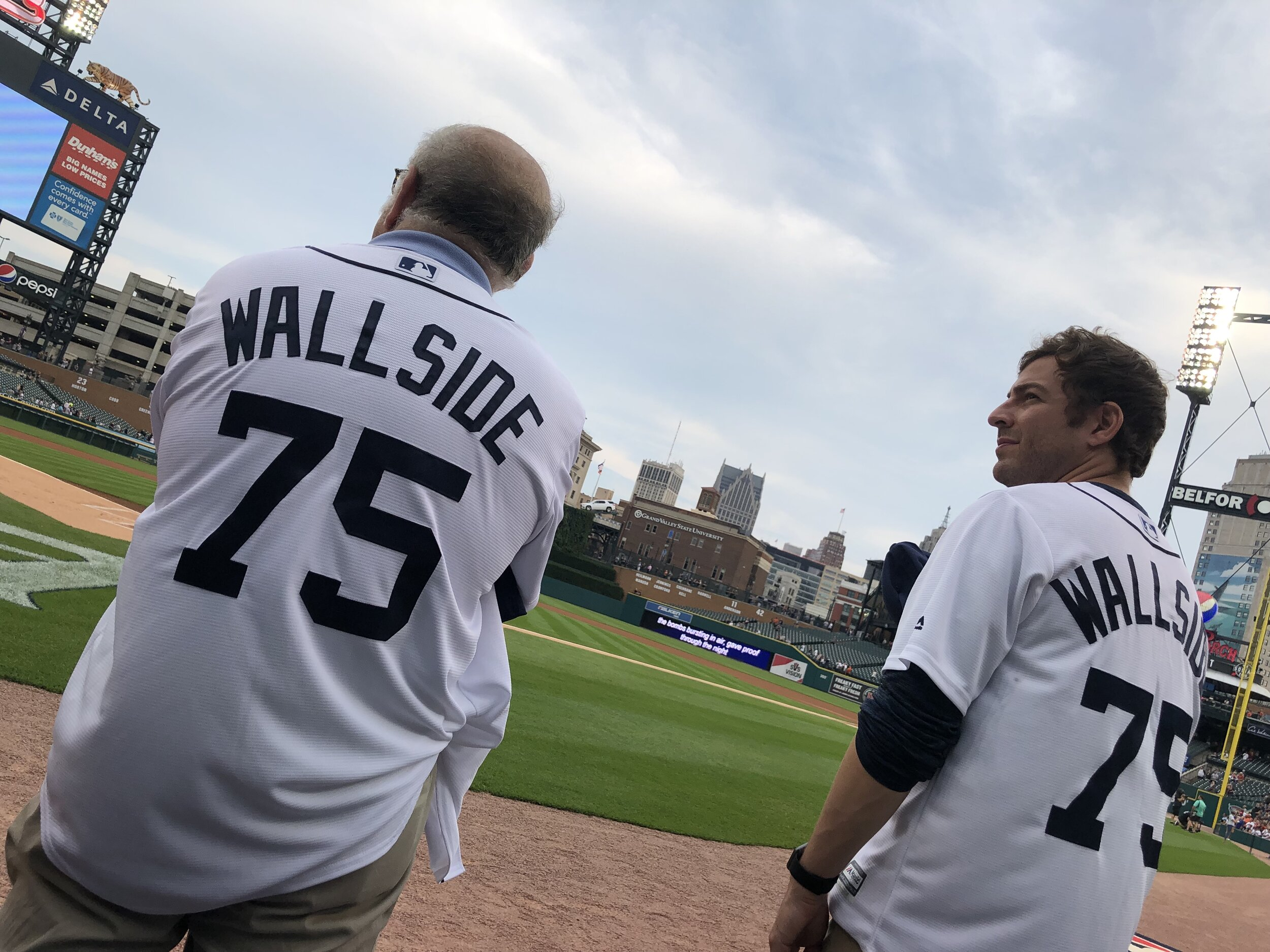 Stanford and Adam Blanck stand on the edge of the field at Comerica Park, just before the start of Tuesday's Detroit Tigers game.