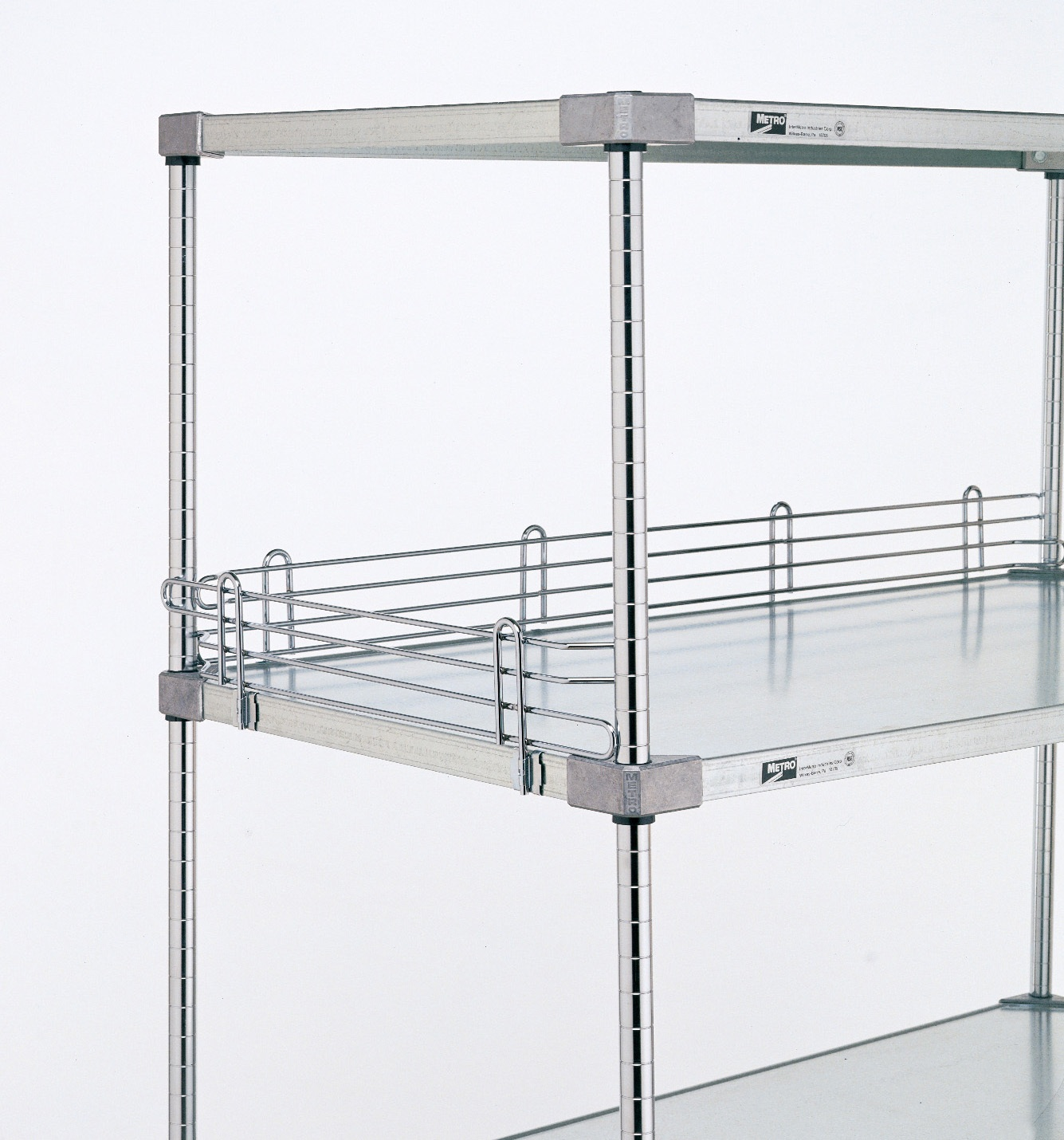 "Solid Shelving - Type 304 Solid Stainless shelving is available in standard format with black epoxy coated corners and all-stainless cart washable / autoclavable. Solid shelves can be easily adapted as a shelving unit, a solid bottom barrier on a wire shelving unit, or as a customizable work station. Raised 1/8"" ship's edges surrounding the perimeter helps contain spills.Standard Stainless Steel with black epoxy corners• Ideal for applications that require a solid surface with a high level of corrosion protection• Available in flat and louvered/embossed styles. Louvered/embossed shelves have holes to allow air circulation.• Shelves up to 48"" (1219mm) have maximum weight load capacity of 800 lbs• 18 gauge galvanized steel shelving also available and suitable for dry environments."