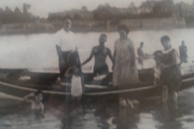 Cynthia's family in a rowboat on the Tigris River