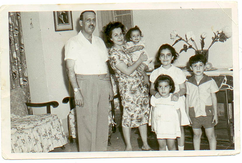 Cynthia as a baby in her mother's arms, her father and her three siblings in their home in Baghdad