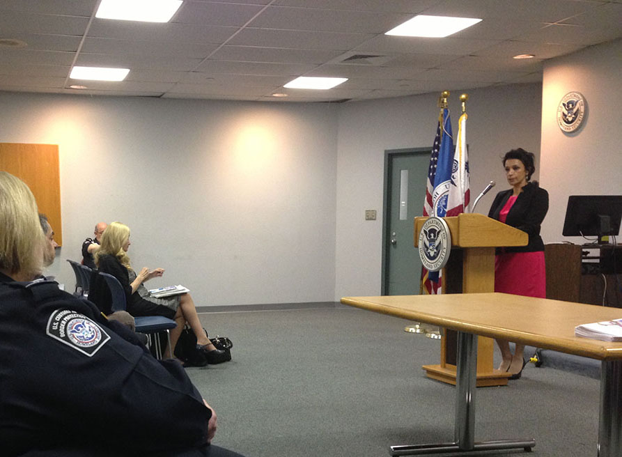 Cynthia speaking to U.S. Customs and Border Protection officers at JFK Airport