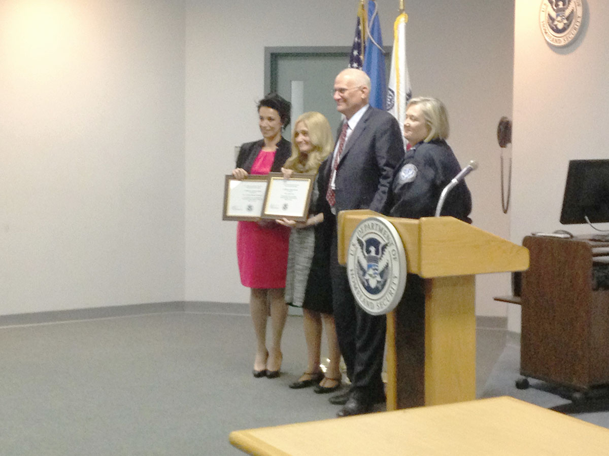 Cynthia receiving certificate of appreciation after JFK speech, with Iraqi-Jewish filmmaker and attorney Carole Basri, U.S. Department of Homeland Security, Customs and Border Protection CFO Melvyn Benison, and JFK Port Director Susan Mitchell